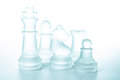 Some glass chess pieces Stock Photos