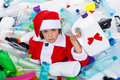 Some more plastic for this christmas sad santa covered in bottles waste Stock Image