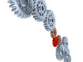 Some silver gears with one red on a white background Royalty Free Stock Photo