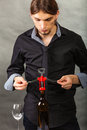Somellier opening bottle with corkscrew. Royalty Free Stock Photo