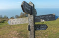 Somerset coastal path sign old wooden of the famous along the exmoor national park in england showing directions and distances to Stock Photo