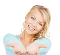 Something on the palms advertisement business promotion concept woman showing of her hands Royalty Free Stock Photos