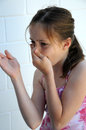 Something stinks girl pinches her nose Stock Images