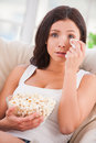 Sometimes i am so sentimental beautiful young woman holding handkerchief and crying while watching movie Stock Image