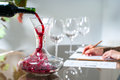 Sommelier pouring wine into decanter. Royalty Free Stock Photo