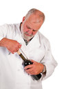 Sommelier removing a cork from a bottle of red wine Royalty Free Stock Photography