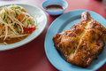 Somtum with chicken grilled on table Royalty Free Stock Photography