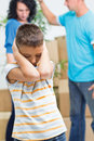 Son agonizes while parents figh young boy Royalty Free Stock Image