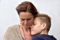 Son comforts mother Royalty Free Stock Photo