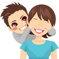 Son covering mother eyes little smiling his happy Royalty Free Stock Image