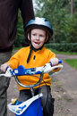 Son with father riding bike Stock Images