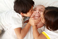 Son kissing their father Stock Photography