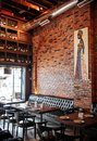 Songkhla - Thailand - Vibrant cool industrial loft restaurant interior style with leather couch, wood chairs and