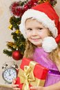 Soon new year little girl at a christmas fir tree Stock Photos