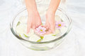 Soothing petal bath spa composition of woman s hands flowers and petals Stock Photo
