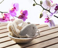 Soothing and softening loofah and pumice stone cure of exfoliation at beauty spa Stock Images