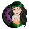 Soothsayer brunette fortune teller holding a sparkling crystal ball in hand Royalty Free Stock Photography