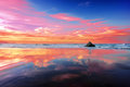 Sopelana beach at sunset with clouds reflections Royalty Free Stock Photo