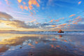 Sopelana beach at sunset with couds reflections Royalty Free Stock Photo