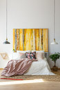 Sophisticated bedroom with contemporary artwork Royalty Free Stock Photo