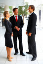 Sophisticated confident business people standing Stock Images