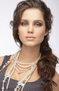 Sophisticated woman with ornamentation pearly necklace classy Stock Image