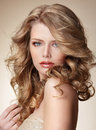 Sophisticated woman with perfect skin and flowing blond healthy hair lady Royalty Free Stock Images