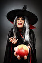 Sorcerer offering a poisoned apple tricky witch halloween theme Stock Images