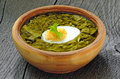 Sorrel soup with egg in brown bowl on the wooden table Stock Photography