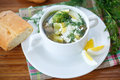 Sorrel soup with and eggs in a bowl on the table Royalty Free Stock Photos