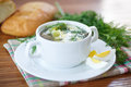Sorrel soup with and eggs in a bowl on the table Royalty Free Stock Image