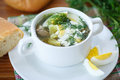 Sorrel soup with and eggs in a bowl on the table Stock Photo