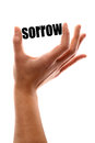 Less sorrow color vertical shot of a hand squeezing the word Stock Photography