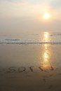 Sorry on beach written in a morning sunrise Stock Images