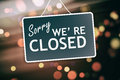Sorry we are closed sign on abstract background Royalty Free Stock Photo