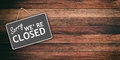 Sorry we are closed sign on wooden background Royalty Free Stock Photo