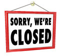 Sorry we re closed hanging sign store closure in a window to represent bankruptcy after hours or going out of business Royalty Free Stock Images