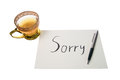 Sorry say with a text message on paper and pen Royalty Free Stock Images