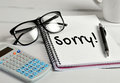 Sorry word on notebook page Royalty Free Stock Photos