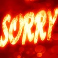 Sorry written on a glowing red background Stock Photos