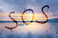Sos rain on glass with text Royalty Free Stock Photography