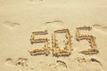 Sos sign made on sand in the beach Royalty Free Stock Image