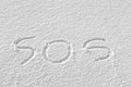 Sos written on the snow Royalty Free Stock Image