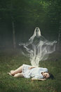 Soul of a sleeping woman in the forest leaving her body surreal and halloween concept Royalty Free Stock Photos