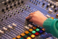 Sound desk a lady adjusts audio settings during a radio broadcast Royalty Free Stock Photos