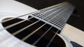 Sound hole and strings of acoustic guitar close up shot Stock Image