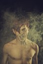 Sound of misery redhead naked young man screaming over dark background Stock Images
