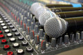 Sound mixing board during a musical performance at Royalty Free Stock Photo