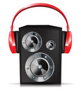Sound speaker with red headphones Royalty Free Stock Photography