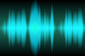 Sound wave light blue waves oscillating on black background Stock Photography